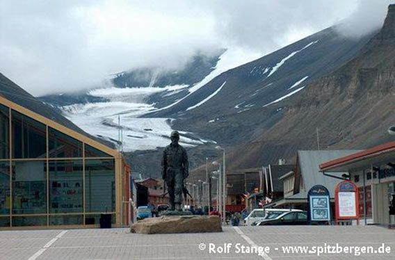 Longyearbyen 'downtown' with supermarket (left) and glacier (background)