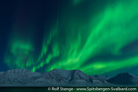 Polar night and northern light near Longyearbyen